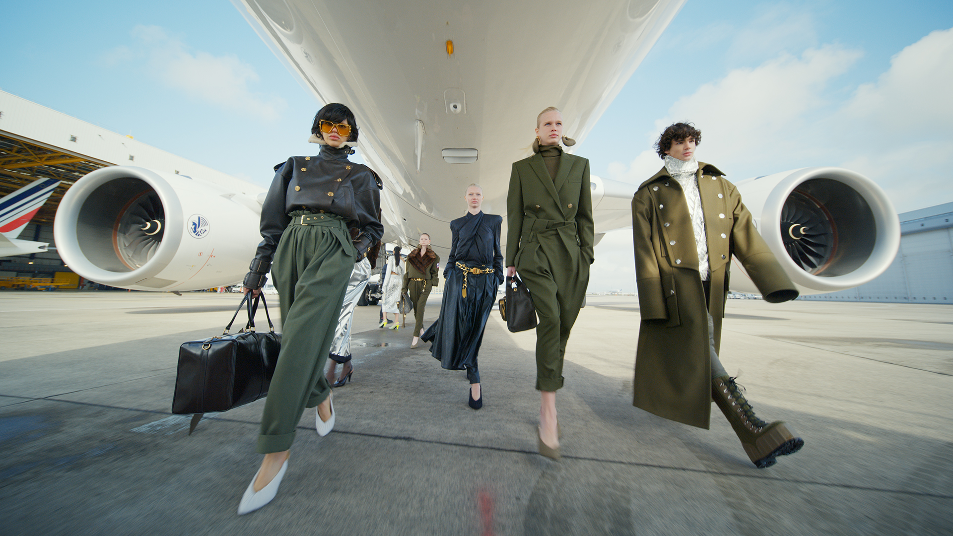 models walking from a plane